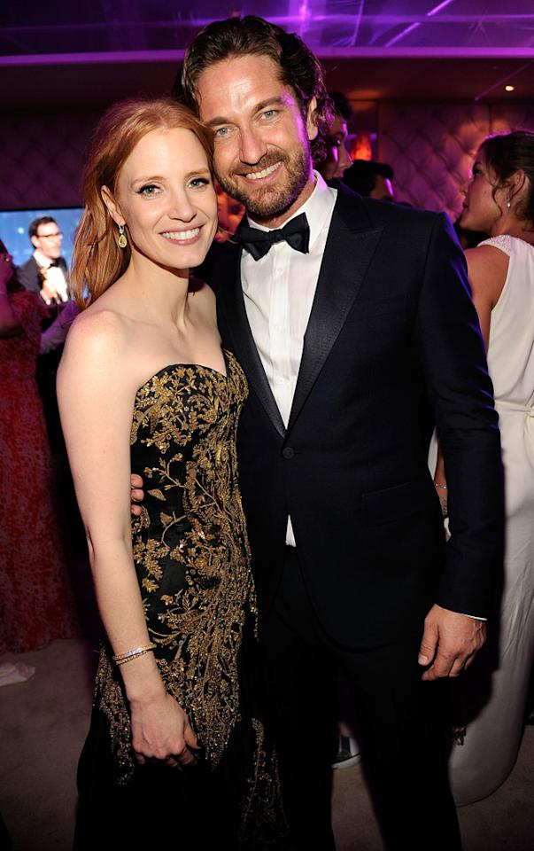 Gerard Bulter put his grubby paws on Jessica Chastain at the Vanity Fair party. She should know better than to mingle with the infamous ladies man.