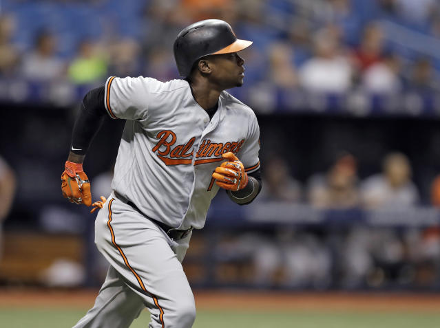 Baltimore Orioles' Tim Beckham watches his home run off Tampa Bay Rays relief pitcher Tyler Glasnow during the fourth inning of a baseball game Tuesday, Aug. 7, 2018, in St. Petersburg, Fla. (AP Photo/Chris O'Meara)