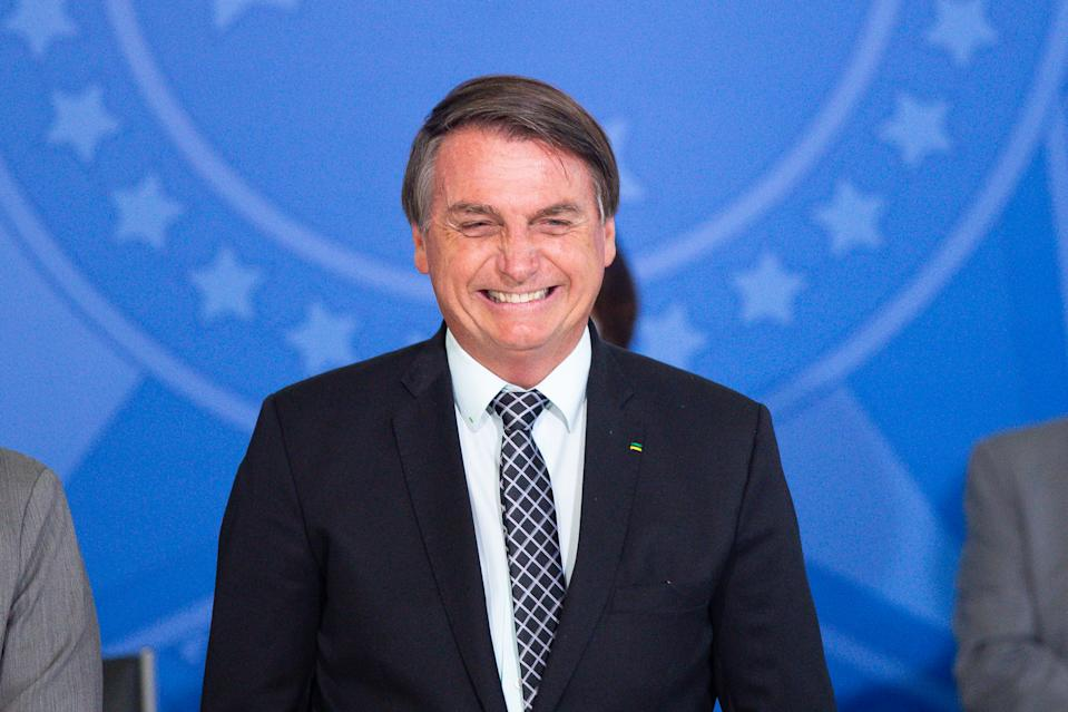 BRASILIA, BRAZIL - OCTOBER 28: Jair Bolsonaro, President of Brazil, smiles during Civil Servant Day Ceremony amidst the coronavirus (COVID-19) pandemic at the Planalto Palace on October 28, 2020 in Brasilia. Brazil has over 5.439,000 confirmed positive cases of Coronavirus and more than 157,000 deaths. (Photo by Andressa Anholete/Getty Images)