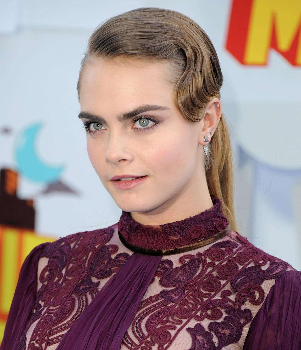 <p>Side parting? Check. Low ponytail? Check. Immaculate finger-wave fringe? Check. Delevingne's 2015 MTV Movie Awards hairstyle combined many of her favorite elements to create one unexpected look. </p>