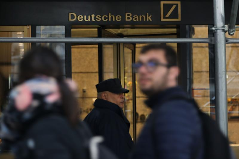 People walk by the New York headquarters for Deutsche Bank in New York City on April 30, 2019. (Photo by Spencer Platt/Getty Images)