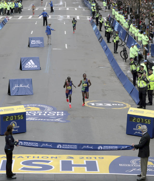 Lawrence Cherono, left, of Kenya, holds off Lelisa Desisa, right, of Ethiopia, to win the 123rd Boston Marathon in front of on Monday, April 15, 2019, in Boston. (AP Photo/Charles Krupa)