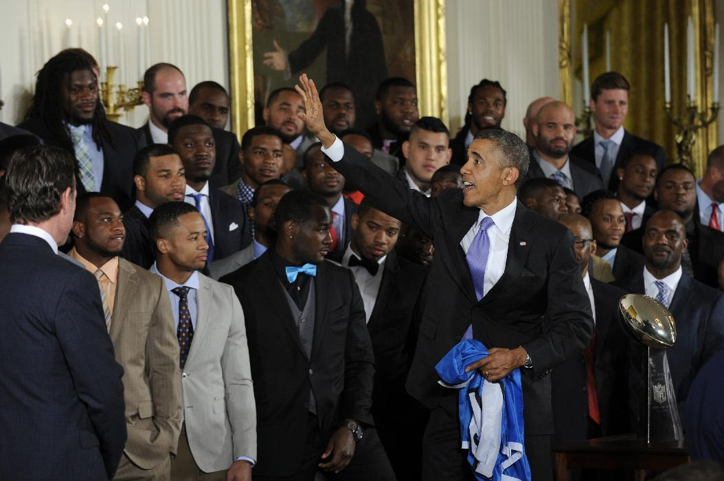 President Barack Obama waves to members of the NFL Super Bowl champion Seattle Seahawks football team after welcoming the team to the East Room of the White House in Washington, Wednesday, May 21, 2014. The Seahawks defeated the Denver Broncos in Super Bowl XLVIII. (AP Photo/Susan Walsh)