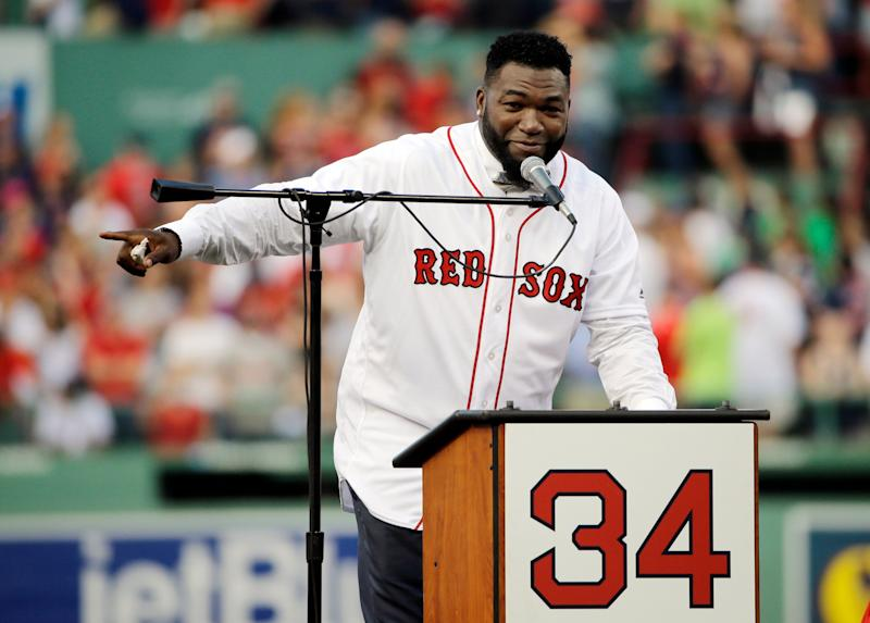 Boston Red Sox baseball great David Ortiz speaks to fans Friday, June 23, 2017, at Fenway Park in Boston as the team retired his No. 34 worn when he led the franchise to three World Series titles. It will be the 11th number retired by the Red Sox. (AP Photo/Elise Amendola)