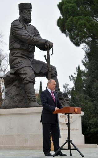 """Vladimir Putin """"does not worship Nicholas II"""" but his father Alexander III, said Orthodox Church expert Ksenia Luchenko. The Russian president is shown here unveiling a monument to Alexander III in Yalta, Crimea, last year"""
