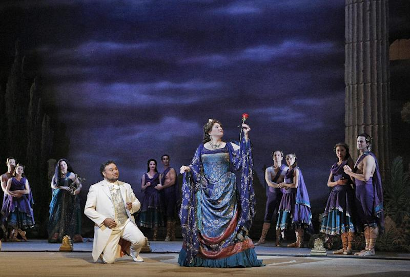 """This undated publicity photo provided by the San Francisco Opera shows Ramón Vargas, left, as Faust and Patricia Racette as Elena in Act IV during the dress rehearsal of """"Mefistofele,"""" in San Francisco. (AP Photo/Copyright San Francisco Opera, Cory Weaver)"""