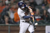 Houston Astros' Jose Altuve hits a grand slam against the San Francisco Giants during the sixth inning of a baseball game Friday, July 30, 2021, in San Francisco. (AP Photo/Tony Avelar)