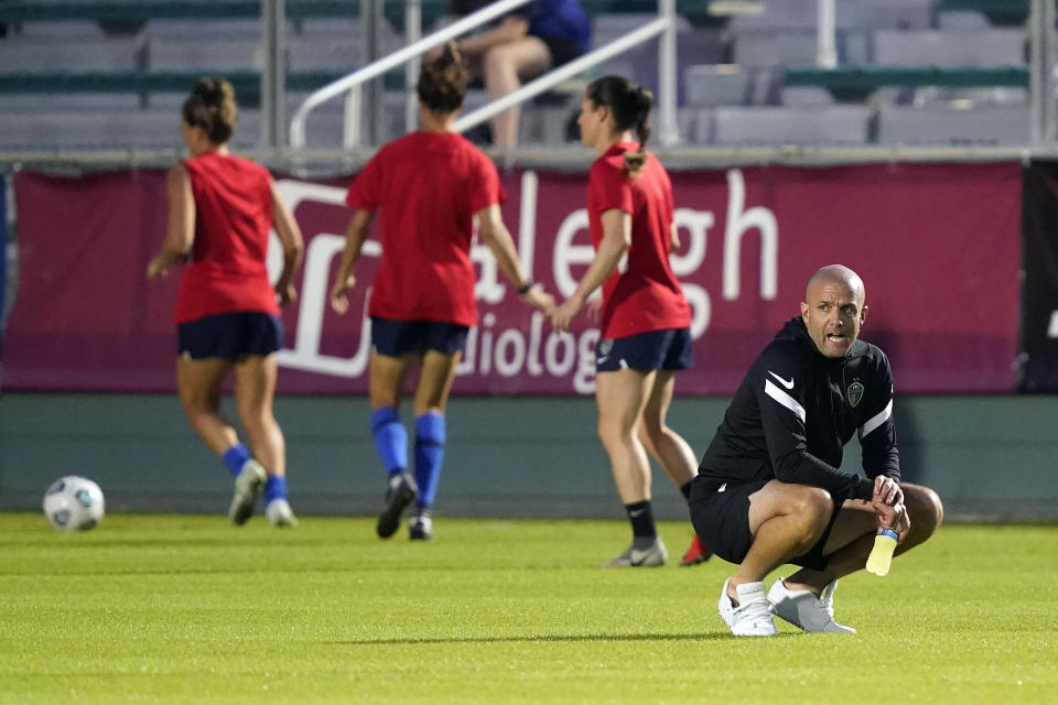 North Carolina Courage interim coach Sean Nahas watches prior to the team's NWSL soccer match against Racing Louisville FC in Cary, N.C., Wednesday, Oct. 6, 2021. (AP Photo/Gerry Broome)