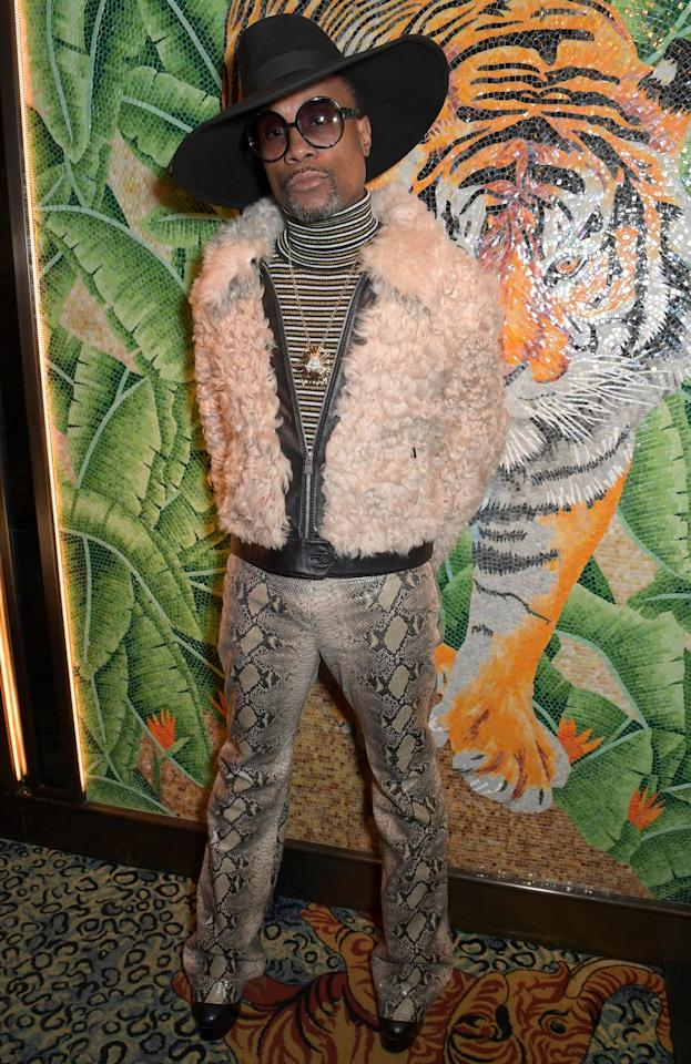 <p>Porter for a shearling cream bomber jacket, striped turtleneck, black wide-brimmed hat, snake-print trousers and boots to the TOMMYNOW after party at member's club Annabel's during London Fashion Week. </p>