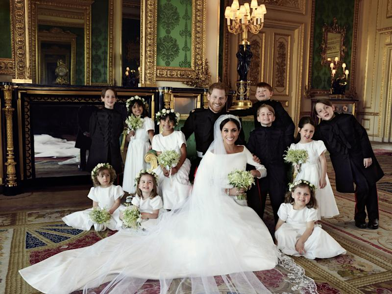 WINDSOR, UNITED KINGDOM - MAY 19: In this handout image released by the Duke and Duchess of Sussex, the Duke and Duchess of Sussex pose for an official wedding photograph with (left-to-right): Back row: Master Brian Mulroney, Miss Remi Litt, Miss Rylan Litt, Master Jasper Dyer, Prince George, Miss Ivy Mulroney, Master John Mulroney. Front row: Miss Zalie Warren, Princess Charlotte, Miss Florence van Cutsem in The Green Drawing Room at Windsor Castle on May 19, 2018 in Windsor, England. (Photo by Alexi Lubomirski/The Duke and Duchess of Sussex via Getty Images) NEWS EDITORIAL USE ONLY. NO COMMERCIAL USE. NO MERCHANDISING, ADVERTISING, SOUVENIRS, MEMORABILIA or COLOURABLY SIMILAR. NOT FOR USE AFTER 31 DECEMBER 2018 WITHOUT PRIOR PERMISSION FROM KENSINGTON PALACE. NO CROPPING. Copyright in the photograph is vested in The Duke and Duchess of Sussex. Publications are asked to credit the photograph to Alexi Lubomirski. No charge should be made for the supply, release or publication of the photograph. The photograph must not be digitally enhanced, manipulated or modified in any manner or form and must include all of the individuals in the photograph when published.