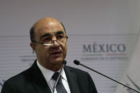 Attorney General Jesus Murillo speaks during a news conference at the attorney general's office in Mexico City December 7, 2014.  REUTERS/Carlos Jasso