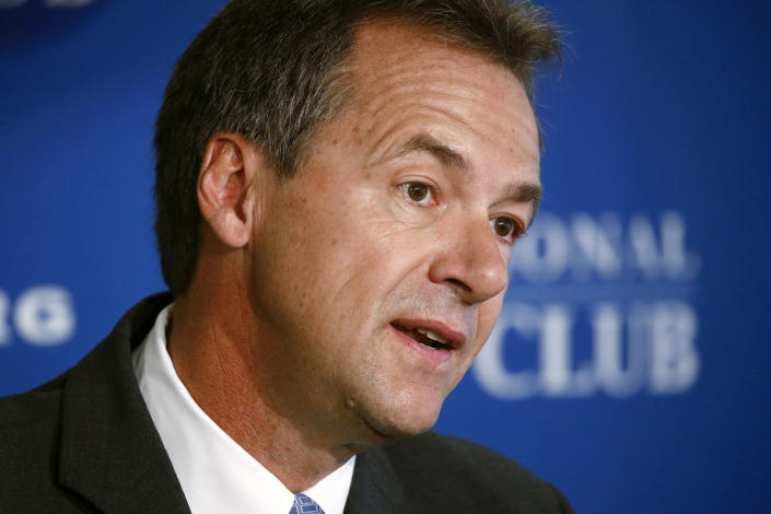 FILE - In this Aug. 7, 2019 file photo, Democratic Montana Gov. Steve Bullock speaks at the National Press Club in Washington. Bullock was the lame-duck governor of solidly red Montana, fresh off a failed Democratic presidential bid, when he pivoted and announced he'd challenge Republican Sen. Steve Daines for his seat. But days after he announced his candidacy last month, the coronavirus claimed its first cases in Montana. That shifted the spotlight onto Bullock as he leads the state's pandemic response, leaving Daines in the unusual position of a sitting senator competing for attention. (AP Photo/Patrick Semansky, File)