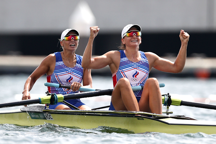 Vasilisa Stepanova and Elena Oriabinskaia of ROC celebrate after winning the silver medal in the women's pair rowing.