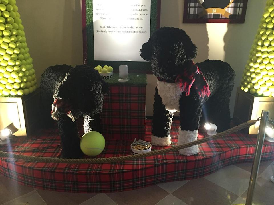 <p>A display East Garden room features larger-than-life replicas of the Obamas dogs, Sunny and Bo. They were made with over 55,000 feet of yarn and 7,000 pom poms. <i>(Photo: Cassie Carothers)</i></p>