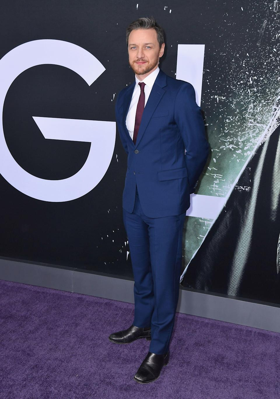 <p>James McAvoy has pulled out all the sartorial stops for his 'Glass' red carpet stint. For the film's New York premiere on January 15, the actor dressed sharp in a navy suit and burgundy-hued tie. <em>[Photo: Getty]</em> </p>