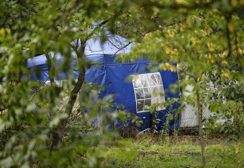 A police tent is seen during the investigation at the allotment garden plot. Source: Ap