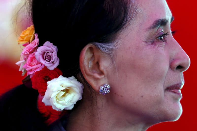 FILE PHOTO: Myanmar's National League for Democracy Party leader Aung San Suu Kyi looks on during a news conference at her home in Yangon