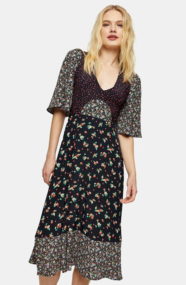 <p>The cut of this <span>Topshop Mixed Print Midi Dress</span> ($95) is very flattering.</p>
