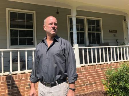 Gerald Bostock, who says he lost his job because he is gay, poses outside his home in Atlanta