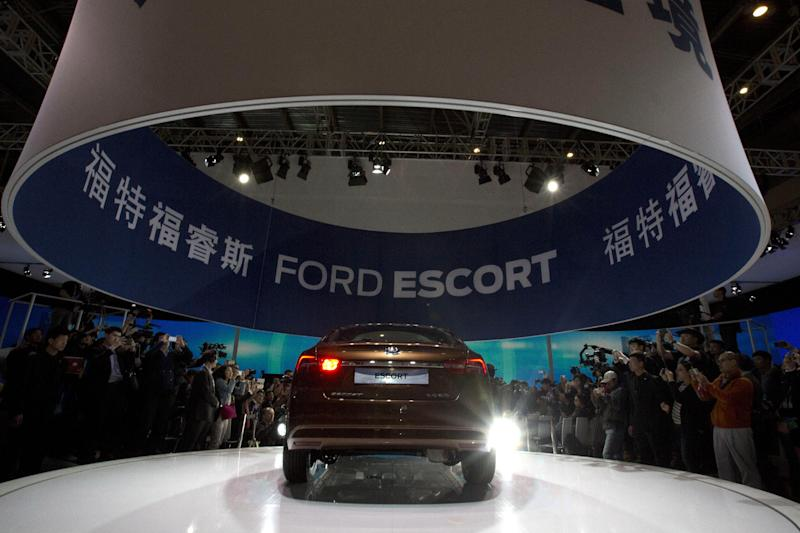 The Ford Escort sedan is unveiled during press day at the China Auto show in Beijing, China, Sunday, April 20, 2014. Ford Motor Co. on Sunday unveiled the new Escort sedan designed in China for global sale at a Beijing auto show that highlighted the growing influence of Chinese tastes on the industry. (AP Photo/Ng Han Guan)