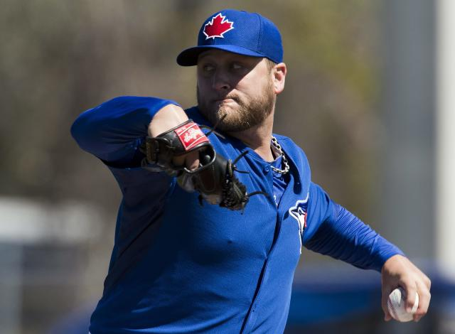 Toronto Blue Jays starting pitcher Mark Buehrle throws during the first inning of a spring exhibition baseball game against the Pittsburgh Pirates in Dunedin, Fla., on Friday Feb. 28, 2014. (AP Photo/The Canadian Press, Frank Gunn)