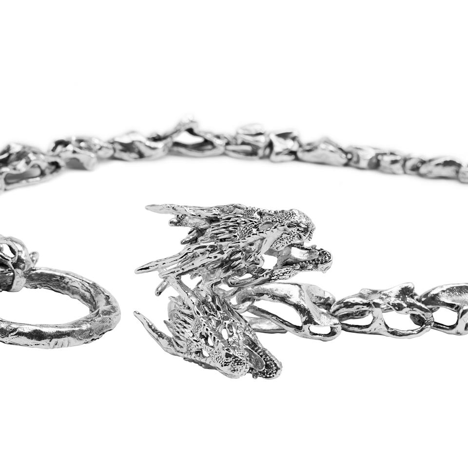<p>This closer look at Dany's chain shows the detail on the three dragon sigil.</p>