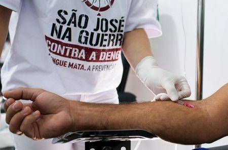 A nurse takes a blood sample to test for dengue fever, in a medical tent in Sao Jose dos Campos, Brazil May 7, 2015. REUTERS/Roosevelt Cassio