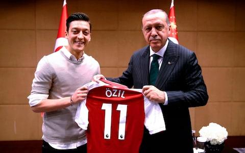 <span>Özil's decision to pose alongside Mr Erdoğan last year set off a political row that culminated in his retirement from the German national team</span> <span>Credit: KAYHAN OZER/AFP </span>
