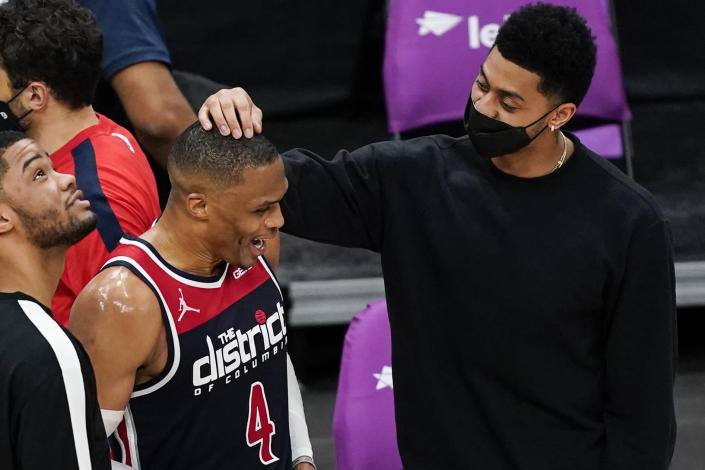 Washington Wizards guard Russell Westbrook (4) talks with Indiana Pacers' Jeremy Lamb, right, after a basketball game, Monday, May 3, 2021, in Washington. The Wizards won 154-141. (AP Photo/Alex Brandon)