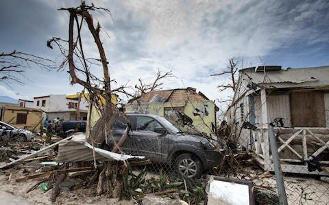 houses and cars damaged after the passage of Hurricane Irma on the Dutch Caribbean island of Sint Maarten - Credit: GERBEN VAN ES/AFP