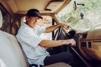 Farmer Jay Ruskey, the Chief Executive of FRINJ Coffee, drives his truck around his farm in California