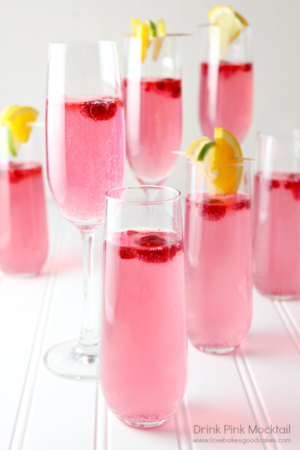 """<p>The vibrant pink in this super-sweet drink is bound to delight all ages. There's white cranberry juice mixed in that gives it a delicious taste.</p><p><strong>Get the recipe at <a href=""""https://www.lovebakesgoodcakes.com/drink-pink-mocktai/"""" rel=""""nofollow noopener"""" target=""""_blank"""" data-ylk=""""slk:Love Bakes Good Cakes"""" class=""""link rapid-noclick-resp"""">Love Bakes Good Cakes</a>.</strong></p><p><strong><strong><a class=""""link rapid-noclick-resp"""" href=""""https://www.amazon.com/Libbey-Selene-Punch-Glasses-Ladle/dp/B000XK4BNE/?tag=syn-yahoo-20&ascsubtag=%5Bartid%7C10050.g.30433150%5Bsrc%7Cyahoo-us"""" rel=""""nofollow noopener"""" target=""""_blank"""" data-ylk=""""slk:SHOP PUNCH BOWLS"""">SHOP PUNCH BOWLS</a></strong><br></strong></p>"""
