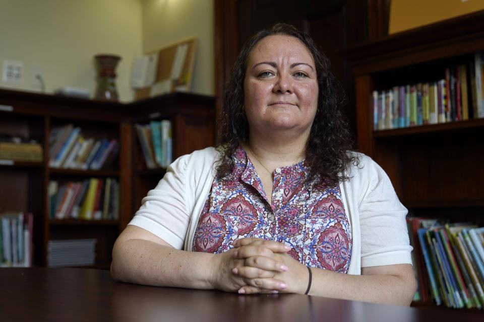 Dr. Michelle LaRue sits for a portrait in Hyattsville, Md., on Wednesday, Aug. 12, 2019. LaRue is a manager at CASA de Maryland, an immigration advocacy group that has partnered with health officials in Prince George's County just outside of Washington. D.C., to make the calls to Spanish speakers. She said earning trust begins with hiring contact tracers who not only speak Spanish but also intimately understand immigrant communities. (AP Photo/Julio Cortez)