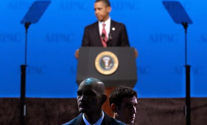 Secret Service agents watch the audience while President Obama speaks in March 2012.