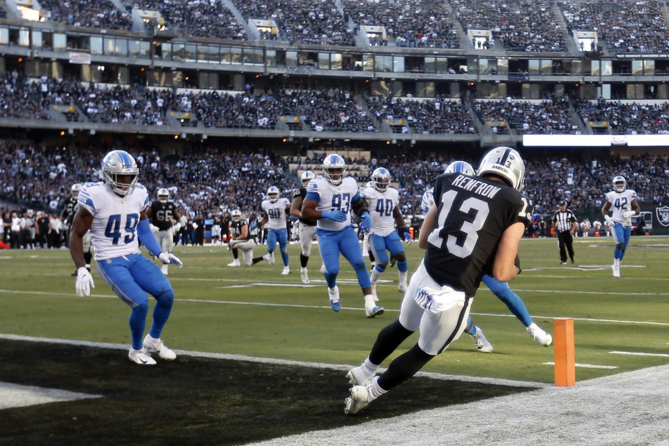 Oakland Raiders wide receiver Hunter Renfrow (13) catches a touchdown pass against the Detroit Lions during the second half of an NFL football game in Oakland, Calif., Sunday, Nov. 3, 2019. (AP Photo/D. Ross Cameron)