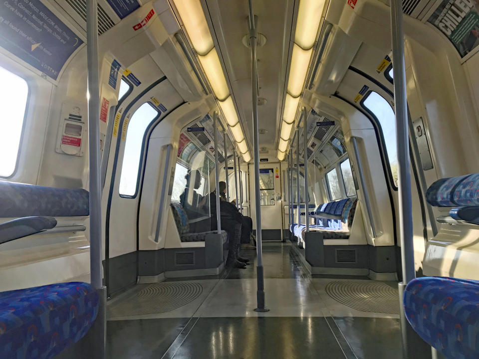 A virtually empty carriage on a Jubilee Line Underground train at rush hour in London, Wednesday, March 25, 2020. For most people, the coronavirus causes mild or moderate symptoms, such as fever and cough that clear up in two to three weeks. (Jonathan Brady/PA via AP)