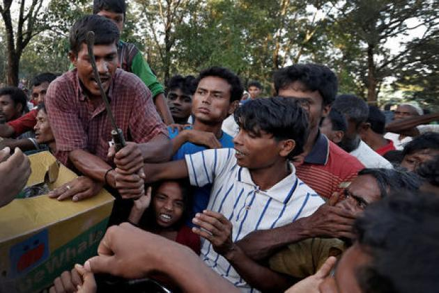Exclusive: 'We will kill you all' - Rohingya villagers in Myanmar beg for safe passage