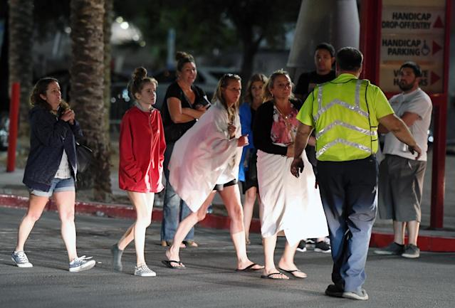 <p>People are directed to rides outside the Thomas & Mack Center after a mass shooting at a country music festival on Oct. 2, 2017 in Las Vegas. (Photo: Ethan Miller/Getty Images) </p>