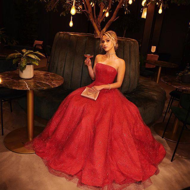 """<p>Smartly pivoting from the success of her breakout turn in <em>Borat: Subsequent Moviefilm</em>, she came out to celebrate her success by more or less announcing herself as your next ingenue, in this classic, sweetly retro gown in an unforgettable shimmering red.</p><p><a href=""""https://www.instagram.com/p/CL2y5K-LBF3/"""" rel=""""nofollow noopener"""" target=""""_blank"""" data-ylk=""""slk:See the original post on Instagram"""" class=""""link rapid-noclick-resp"""">See the original post on Instagram</a></p>"""
