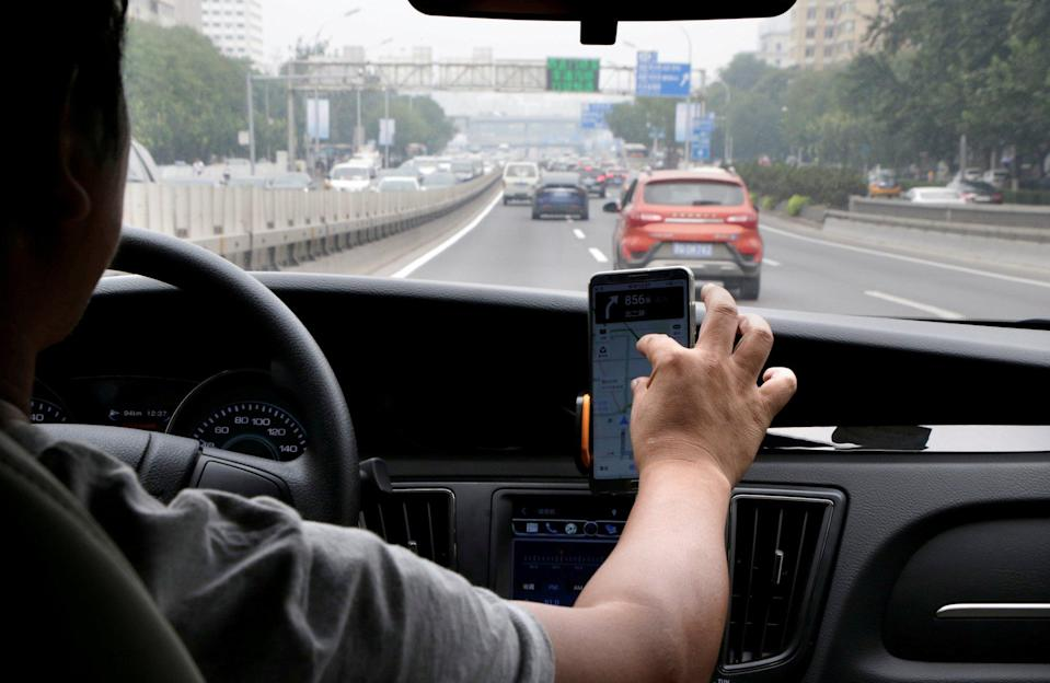 A Didi Chuxing driver on the job in Beijing in 2018. Photo: Reuters