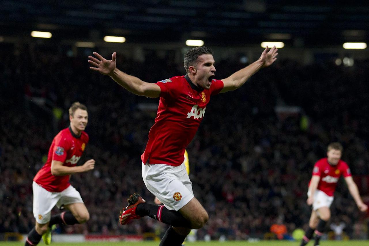 Manchester United's Robin van Persie celebrates after scoring against Arsenal during their English Premier League soccer match at Old Trafford Stadium, Manchester, England, Saturday Nov. 10, 2013. (AP Photo/Jon Super)