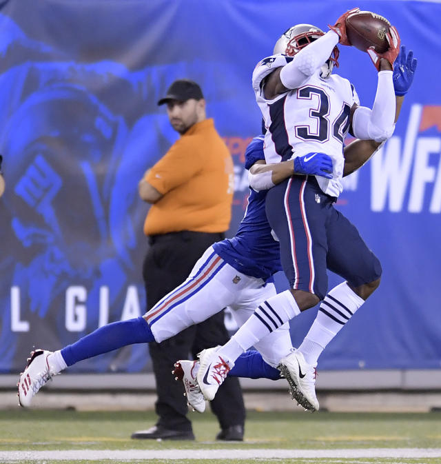 New England Patriots defensive back J.C. Jackson, front, intercepts a pass from New York Giants quarterback Kyle Lauletta, not pictured, intended for New York Giants wide receiver Kalif Raymond, back, during the first half of an NFL preseason football game, Thursday, Aug. 30, 2018, in East Rutherford. (AP Photo/Bill Kostroun)