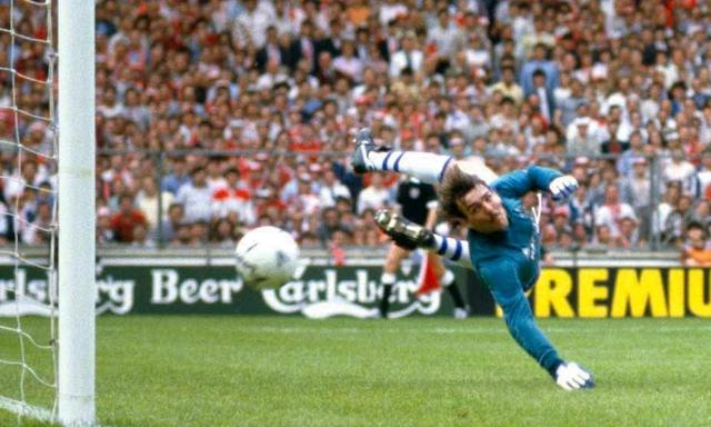 Everton goalkeeper Neville Southall is beaten by a shot from Norman Whiteside, who scores the only goal of the match in the 1985 FA Cup Final.