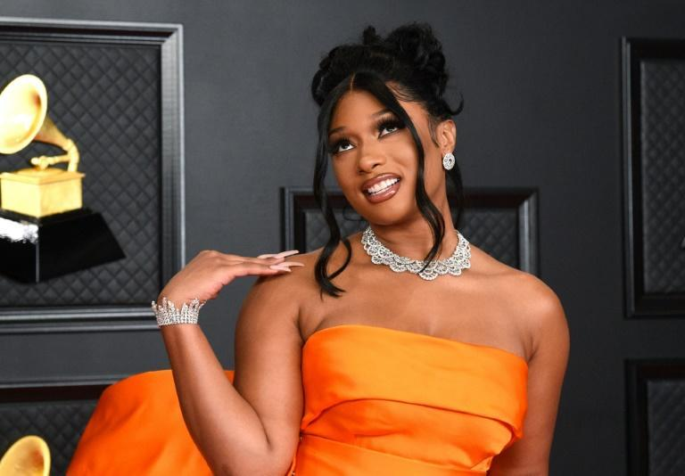 US rapper Megan Thee Stallion dazzles in orange on the Grammys red carpet