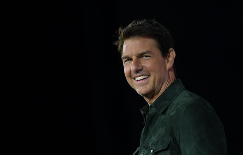 Actor Tom Cruise makes a surprise appearance in Hall H to promote Top Gun: Maverick at the Convention Center during Comic Con in San Diego, California on July 18, 2019. (Photo by Chris Delmas / AFP) (Photo credit should read CHRIS DELMAS/AFP via Getty Images)