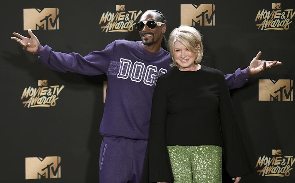 """FILE - In this May 7, 2017 file photo, Snoop Dogg, left, and Martha Stewart pose in the press room at the MTV Movie and TV Awards in Los Angeles. The domestic diva who brought us hemp yarn is now partnering with Canada's Canopy Growth Corp. to develop new products containing CBD, a compound derived from hemp and marijuana that doesn't cause a high. Stewart's tie-up with Canopy may not be a surprise to her fans. In 2015, she baked brownies on """"The Martha Stewart Show"""" with marijuana aficionado Snoop Dogg, and hinted that Snoop could add a little weed if he wanted to. (Photo by Richard Shotwell/Invision/AP, File)"""