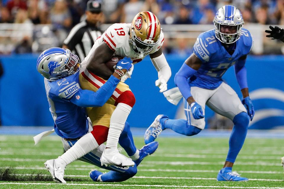 Detroit Lions cornerback Jeff Okudah (23) tackles San Francisco 49ers wide receiver Deebo Samuel (19) during the first half at Ford Field in Detroit on Sunday, Sept. 12, 2021.