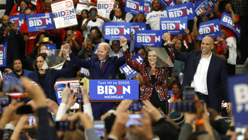 Sen. Kamala Harris, D-Calif., from left, Democratic presidential candidate former Vice President Joe Biden, Michigan Gov. Gretchen Whitmer, and Sen. Cory Booker D-N.J. greet the crowd during a campaign rally at Renaissance High School in Detroit, Monday, March 9, 2020. (AP Photo/Paul Sancya)
