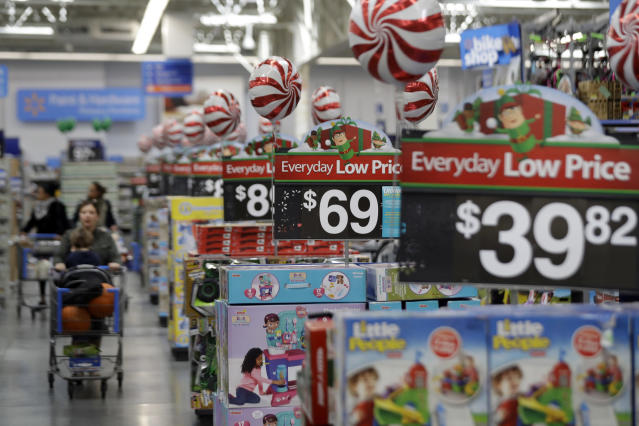FILE - This Oct. 26, 2016, file photo, shows prices in the toy section at Walmart in Teterboro, N.J. An escalating trade war with China could mean higher prices on a broad array of products from toys to clothing. But some retailers will feel more pain than others, further deepening the divide between the winners and the losers that was evident in the latest earnings reports. Analysts say big box giants like Walmart and Target, which have had strong performances, are best positioned to absorb the higher costs because of their clout with suppliers. (AP Photo/Julio Cortez, File)