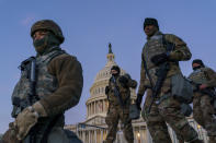 FILE - In this Jan. 19, 2021, file photo National Guard troops reinforce the security zone on Capitol Hill in Washington. Over the past year, National Guard members have been called in to battle the COVID-19 pandemic, natural disasters and race riots. (AP Photo/J. Scott Applewhite, File)